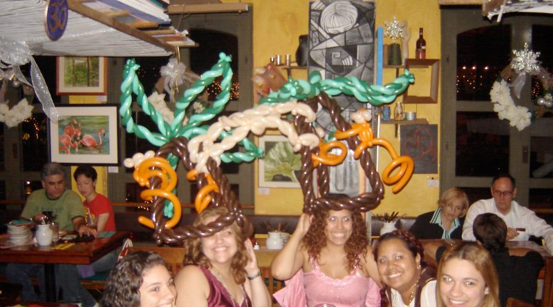 Balloon monkeys on four balloon tree hats connected by a balloon volleyball net