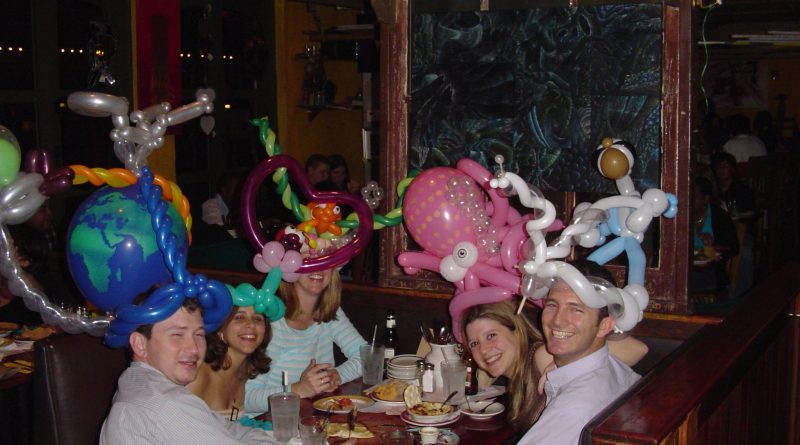 Photo of customers in a restaurant with amazing balloon hats.