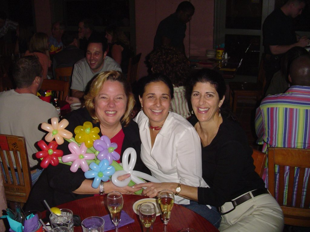 Smiling ladies with a balloon flower bouquet at a restaurant
