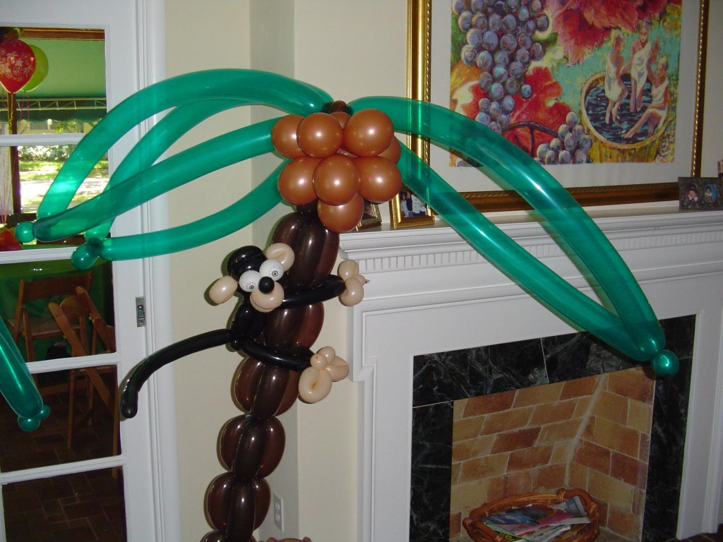 Balloon monkey on palm tree with framework