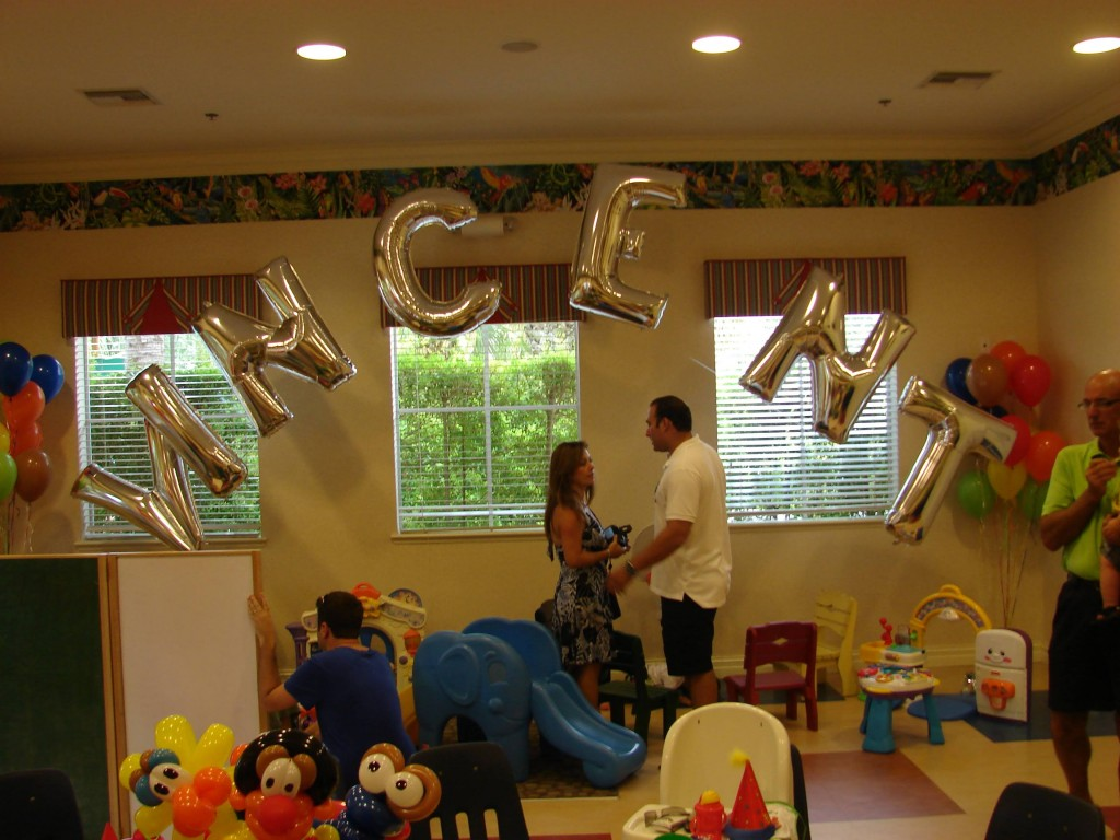 Big balloon letters with bouquet at Sesame Street themed party