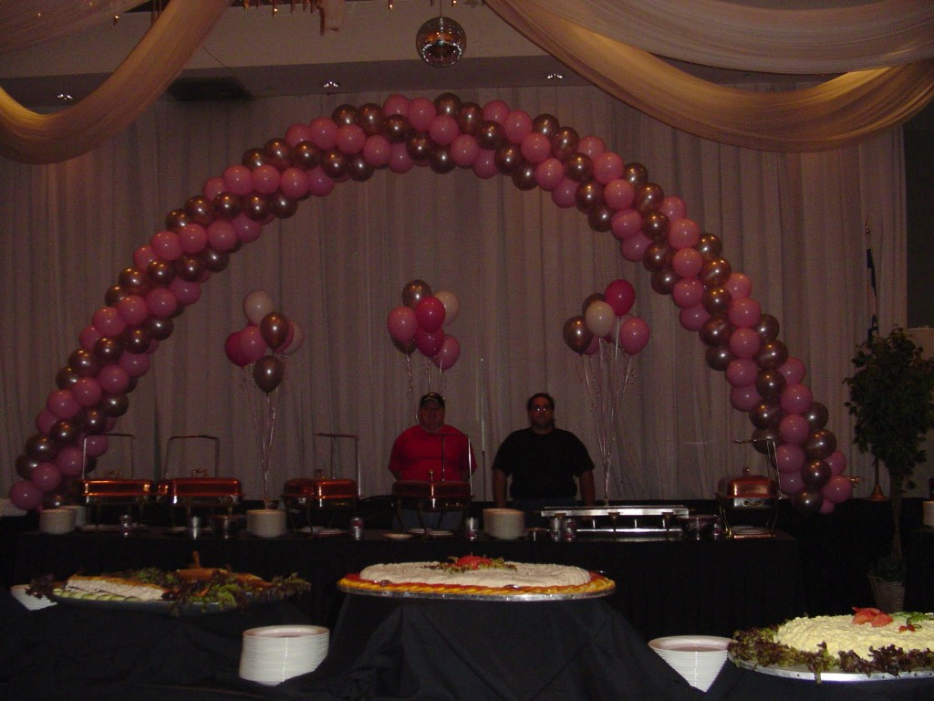 Giant helium filled balloon arch and bouquets