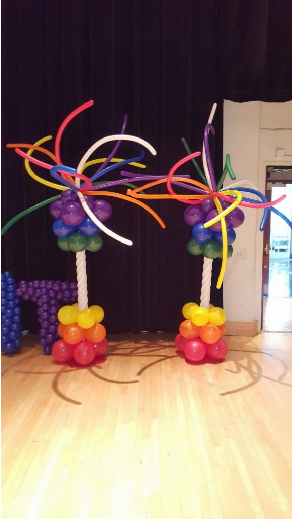 Rainbow colored funky balloon columns for the Arsht Pride event