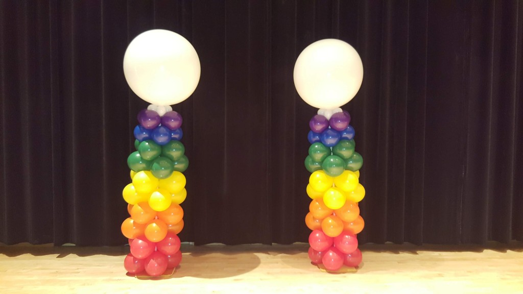 Rainbow tapering balloon columns for arsht pride event