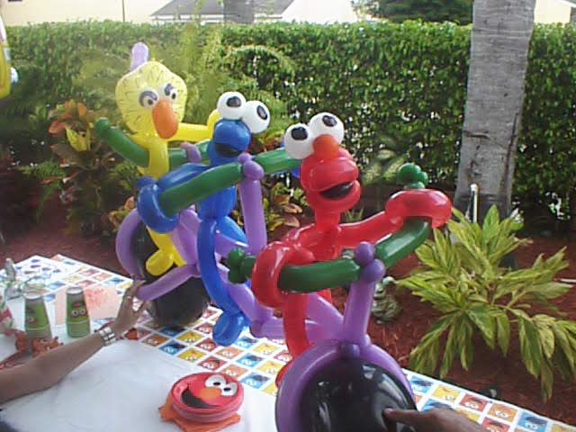 Sesame street balloon character parodies riding a bike together number two