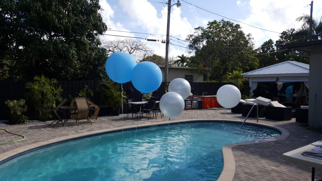 Three foot balloons in a pool